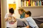 Children discussing their works