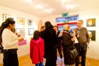 Visitors looking at the exhibition