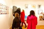 Artist Karen Parker shows a visitor how to manipulate her work